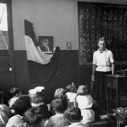 It is 1943, I am a high school teacher in Paris, France. We have been under German occupation for 2 years now. How has my teaching curriculum changed under Nazi rule?